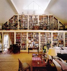 Awesome bookshelf / wall. How I think my house would look like...