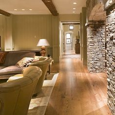 Stone wood basement Ideas. Good idea if we can't hide some poles in the walls.