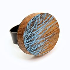 "Julia Turner ""Blue Field Ring"", 2014. Wood, paint, sterling silver. .9 x .8 x .9 in (2.5 x 2.22 x 2.5 cm)."