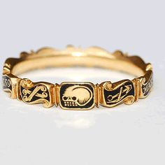 Memento Mori gold and black enamel scrolled Rococo band dated 1745. The enamelled scrolls read : Mary Mount Ob 26 June 1745 aet 59 and the front scrolls are decorated with a skull, crossbones and a gravedigger's pick and shovel