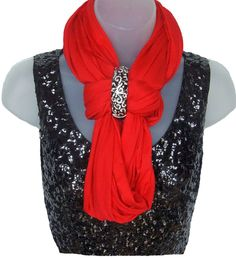 Bundle up and add the Tiffie Forever Scarf to for a splash of color. Embellish with a sparkling clutch bracelet for this look. $36 www.TheTiffie.com