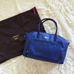 NWOT KS Alexander Avenue Large Catalina NWOT large, roomy cobalt ostrich Kate spade purse with removable shoulder strap and dust bag. I love this purse, but I've owned it for 3 years and have yet to use it. In pristine shape, as it has been sitting in its dust bag. kate spade Bags