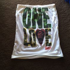 """Bob Marley One Love Rasta Tube Top Worn once. Good condition. No wear and tear or stains. 50% cotton, 50% polyester. Size XL. Measures 19.5"""" in length. Catch A Fire Tops"""