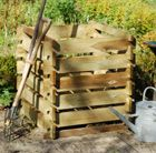 A traditional style composter made from pressure-treated FSC wooden slats.