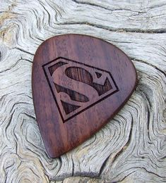 African Leadwood - Handmade Laser Engraved Premium Wood Guitar Pick - Superman Tribute on Wanelo