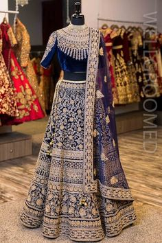 Beautiful heavy work blue velvet wedding lehenga. Click on image to know the price. #Frugal2Fab