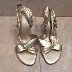 Gold leather sling-back 3 inch heels- by Aldo Gold leather open toe, sling-back 3 inch heel by Aldo. Size 37. Worn once, looks great with dress or cute skirt. Negotiable ALDO Shoes Heels