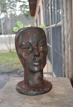 faux rusty cast iron head planter, crafts, gardening, painting, repurposing upcycling, After picture