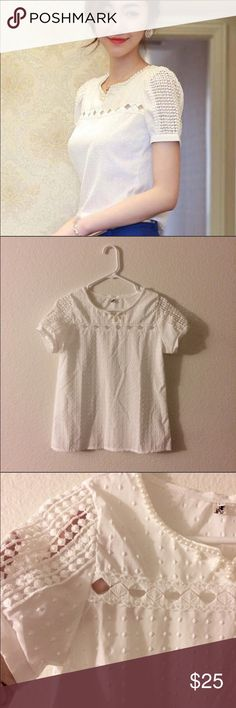 White chiffon top with beading Fits like a small. NWOT. Beautiful details on shoulder & collar area. Never worn. Fits true to size small and material is chiffon. Top is the color white. Tops Blouses