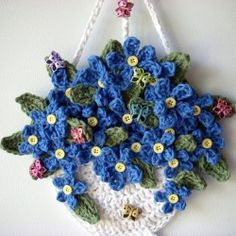 Crochet hanging basket flowers, wall hanging, my own design, no pattern, by Jerre Lollman The Knitted Garden Exhibit needs more hanging baskets - can you add one to the collection? Crochet and Knitting Free Pattern [gallery columns= could be a fun way to Crochet Puff Flower, Knitted Flowers, Crochet Flower Patterns, Crochet Motif, Crochet Wall Art, Crochet Wall Hangings, Crochet Wreath, Crochet Decoration, Crochet Gifts