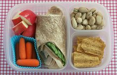 Bento lunch box for mom - half of a turkey sandwich wrap (from an impromptu Costco lunch the day before), carrots, chopped apple, pistachios and some SunChips.