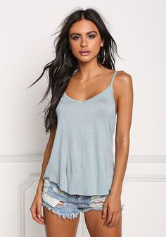 dcd059a251b20 An essential everyday tank top in a jersey knit bodice solid all throughout.