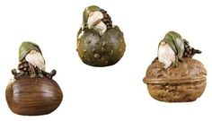 """Gift Craft 4.5-Inch Polystone Gnome-on-a-Nut Design Figurines, Small by Gift Craft. $26.61. Outdoor safe. Durable polystone construction. Flat base allows piece to stand freely in any garden setting. Add a touch of enchantment to any outdoor setting with this set of three garden gnome figurines. crated in polystone, each unique design features a gnome character sitting atop a nut like base. measures 3.9"""" x 3.2"""" x 4.5""""."""