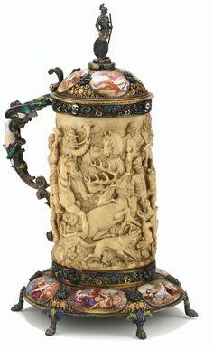 AN IVORY TANKARD WITH ENAMELLED SILVER-GILT MOUNTS, AUSTRO-HUNGARIAN, LATE 19TH CENTURY.