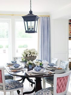 Love the pink pop on the chair backs...a clever suprise Blue and white dining room with lantern