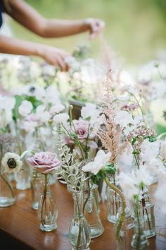 Budget saver!! Instead of giant low centerpieces, scatter several small vessels holding a flower or two in the center of the table. Style Me Pretty | GALLERY & INSPIRATION
