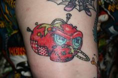 Her name is Psycho Sue & she has a gift when it comes to the needle and thread and designing clothes.  Her tattoo is the infamous tomato pincushion turned undead & zombie-ish! LOVE it!