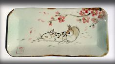 A sushi-style tray with hand painted rabbits under Spring plum blossoms by Tracie Griffith Tso of Reston, Va. Sushi Style, Bunny Art, Bunny Rabbits, Blossoms, Ideas Para, Plum, Tray, Chinese, Pottery