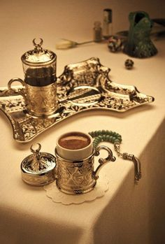 Turkish coffee set.me and my sister went thrift she found an awesome set like this we were in discussion about what kind of tea or coffee set it was, she said it may be Turkish a women came by trying to shoot down that idea.Smh we maybe young but we know a little something about something. Lol