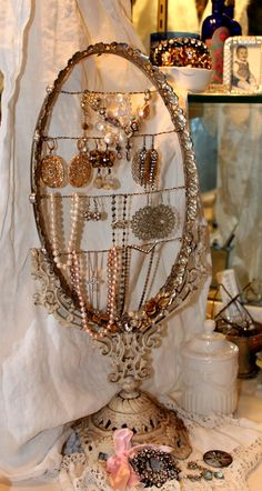 Vintage 2 Creations - this is a jewelry display stand made from an old mirror and a dresser tray. clever.