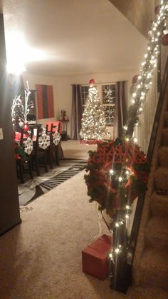 Staircase decorated with lights and wreath... Christmas