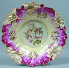 RS Prussia BowL magnolias, on a pale yellow ground and again around the bowl wall, deep rose accent around rim with ghost flowers and leaves and peach accents to mold flowers, gold highlights to mold features.