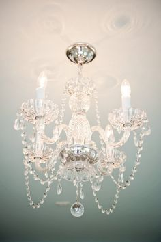 "I have almost this same exact chandelier in my storage - it was my grandmother's :) Ours have hurricanes around the ""candles"" and doesn't have the connecting crystal strands anymore because apparently they were lost years ago"