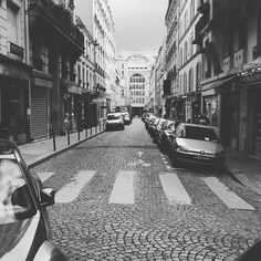 One second later the car's going to hit the photograph - but this pic's worth it isn't it? #France #Paris #street #citylife #urbanlife #streetlife #streetphotograhy #blackandwhite #parisguide #instaparis #travel #instatravel #cars
