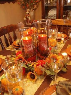 Fall table decor with candles and fall flowers