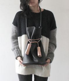 i want the sweater, not the bag.