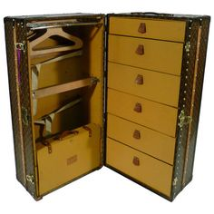 Louis Vuitton Wardrobe Trunk with Key, circa 1930s, Malle Armoire | HEIGHT: 44.49 in. (113 cm) WIDTH: 22.05 in. (56 cm) DEPTH: 21.65 in. (55 cm) DEALER LOCATION: Haguenau, France NUMBER OF ITEMS: 1 REFERENCE NUMBER:From a unique collection of antique and modern trunks and luggage at https://www.1stdibs.com/furniture/more-furniture-collectibles/trunks-luggage/