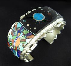Stunningly beautiful Alvin Yellowhorse sterling silver inlay cuff bracelet. The detail craftsmanship of this piece is almost beyond comparison. Impressive...