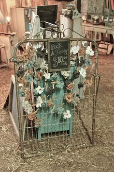 A garden gate for pinning small items for sale (from Vintage Junky - Creating Character)