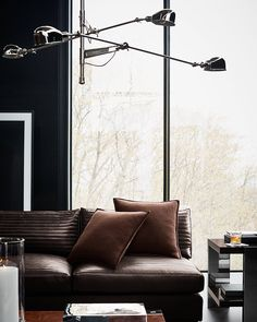 Beloved pieces take new form in the #RLHome Modern Icons collection – like the Desert Modern Sectional in a channeled leather technique typically seen in automotive interiors and the RL '67 Boom Arm Lamp in a new triple arm chandelier