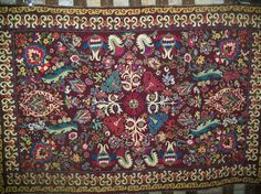 it is lakey suzani silk on cotton rear piece can be use as a bed cover or table cover  size is145x210cm