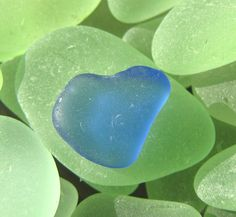 great colors of beach glass! beautiful blue almost heart shaped.