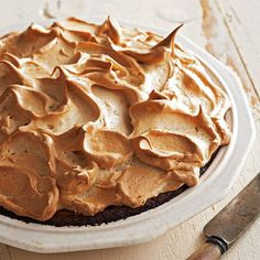 A gingersnap crust adds a hint of zest to every bite of this maple-syrup-and-pumpkin pie: http://www.bhg.com/recipes/desserts/pies/pumpkin/pumpkin-pie-recipes/?socsrc=bhgpin092414gingermeringuepumpkinpie&page=11