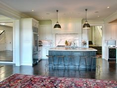 Once the concrete is sanded down and polished or sealed, it looks perfectly refined in a traditional kitchen or living room, especially when layered with Oriental rugs and pretty furnishings and fixtures. By Christian Gladu Design. Via Houzz.