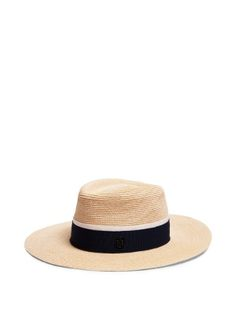 Maison Michel has been crafting the most elegant hats since 1936. This beige Charles design is woven from canapa straw to a refined fedora shape, and topped with a navy and white woven-grosgrain band. It's a perfect finishing touch to warm-weather looks.