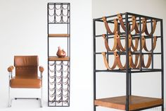 Arthur Umanoff Wroght iron leather wine rack - modern furniture at its finest. available here: http://theswankyabode.com/collections/storage-and-tables/products/arthur-umanoff-wrought-iron-and-leather-wine-rack-01191613