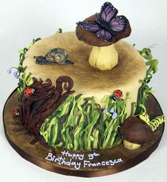 Adorable woodland/bug cake.  A fairy would be nice, too.  ;)