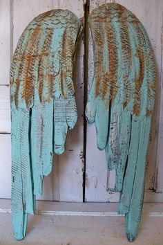 Turquoise wings.Would be great on outdoor fence.♥