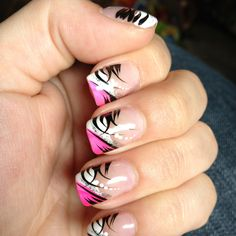 Pink, black, and white nail design