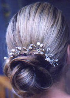 Classic bridal lower updo with floral hairclip.PNG