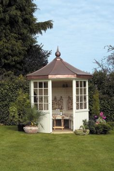 The octagonal Balmoral summer house by Scotts of Thrapston has a copper roof and is finished throughout in pressure treated timber. The door can be removed and stored on side brackets when in use. It also comes with fitted storage cupboards and optional seating and upholstery.