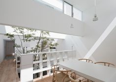 Japanese studio UID Architects often place gardens inside buildings and this house in Fukuyama is no exception