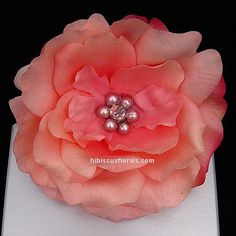 Coral pink real touch camellia hair flower accessory with pearls in full view