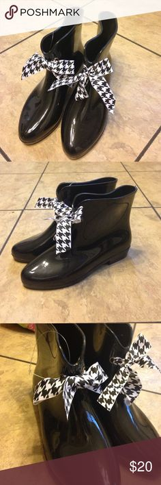 Rain boots Shiny black rain boots that come to the shin, black and white houndstooth ribbon, new, never been worn Shoes Winter & Rain Boots