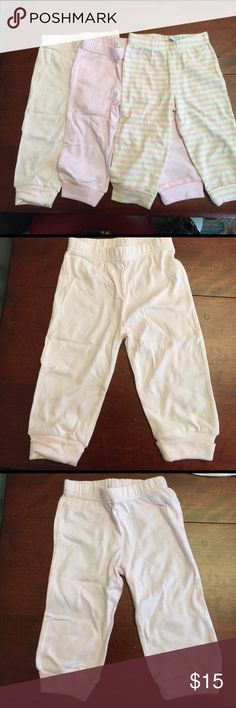 Three pair pants new 6-9 months. Three pair pants new 6-9 months. Solid pink, stripped white and pink, stripped green and pink. Bottoms