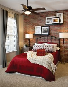 Love the shelves on the brick wall.